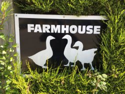Farmhouse Campsite entrance sign